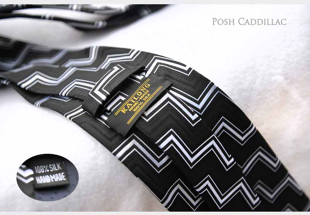 Black-white-cubic-zig-zag-pattern-posh-cadillac-below-web-txt