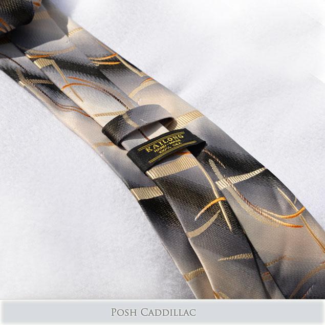 Creamy-gold-curves-on-grey-black-tie-posh-cadillac-below-web-S