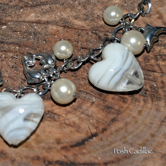 Unique-handmade-white-murano-hearts-with-silver-dolphins-adjustable-chain-Posh-Cadillac-detail-web-S