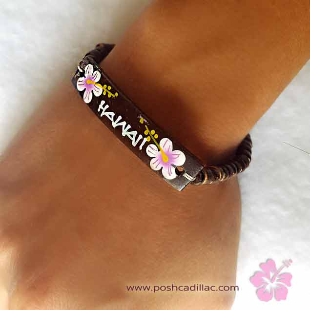 handmade-handpainted-novelty-souvenir-traditional-hawaiian-wooden-bracelets-hawaian-pink-white-on-hand-posh-cadillac-web-s